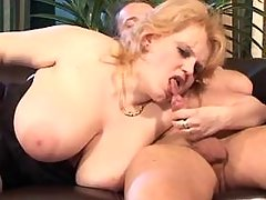 Chubby mature sucks cock on sofa