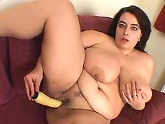 Lonely fat vixen dildofucks on sofa