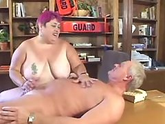 Playful fat lady sucks and titfucks