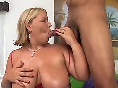 Chubby blonde gets cumshot on tits