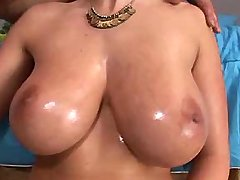 Babe with huge boobs sucks big cock