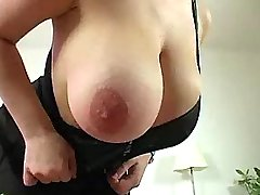 Cute busty redhead shows huge boobs