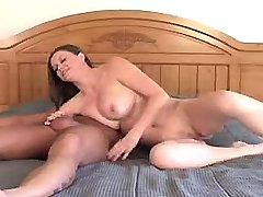 Horny busty beauty sucking big cock