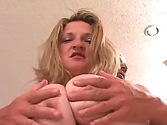 Busty mature gets cream on her tits