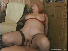 Hairy jan bent over an armchair for sex